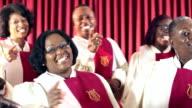 Group of black men and women singing in church choir