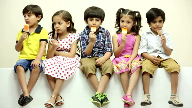 Group of boys and girls eating ice cream