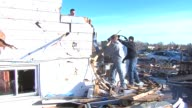 Group Of Boys Cleaning Up Rubble After Tornado on November 18 2013 in Washington Illinois