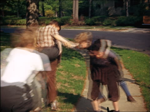 1940 group of boys playing chicken (fighting on piggyback) in yard / Maplewood, NJ / home movie