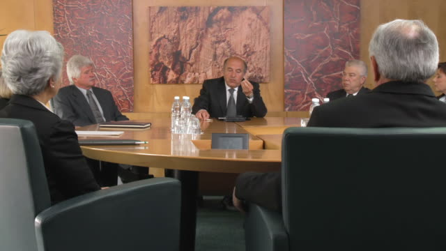 HD: Group of Business People Having Board Meeting