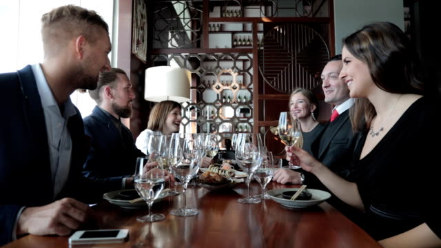 Group of business people toasting at restaurant