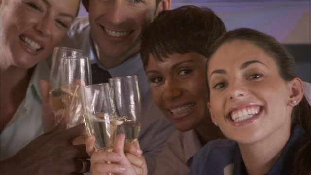CU, Group of businesspeople in conference room laughing and toasting with champagne, portrait, Los Angeles, California, USA