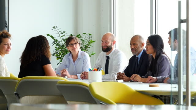MS Group of businesspeople in meeting in office conference room