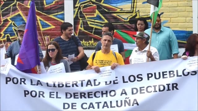 A group of Catalans protest Wednesday in front of the Spanish embassy in El Salvador against the Spanish government that is trying to stop the...