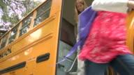 MS, LA, Group of children (6-7, 8-9) getting off school bus