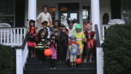 WS TD Group of Children in Halloween Costumes Leaving Home to Collect Candy / Richmond, Virginia, USA