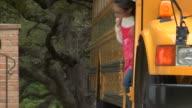 MS, Group of children (6-7, 8-9) leaving school bus
