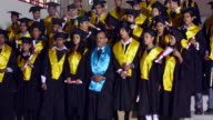 Group of college students celebrating graduation day in the college