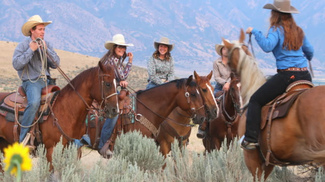 Group of Cowboys and Cowgirls on Horseback