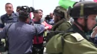 A group of demonstrators stage a rally to demand the release of Palestinian prisoners held in Israeli jails at the Haware checkpoint near the West...