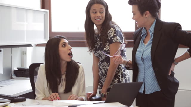Group of diverse female executives collaborate on ideas