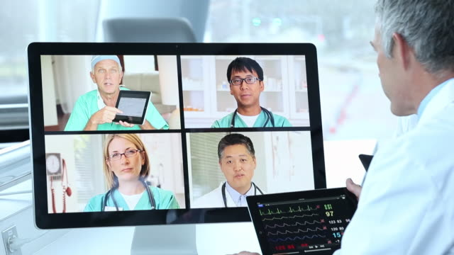 CU TU Group of Doctors Video Conferencing in Corporate Office, Discussing Patient Medical Information / Virginia Beach, Virginia, United States
