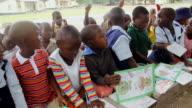 MS Group of eager schoolchildren observing teacher / Save Valley, Southern Zimbabwe, Zimbabwe
