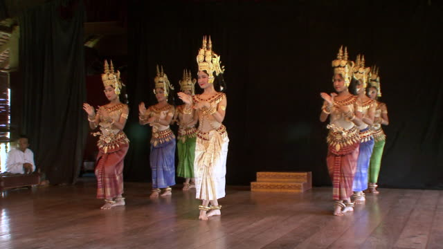 MS Group of female apsara dancers performing dance on stage / Phnom Penh, Cambodia
