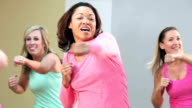 Group of five women doing aerobics or dance routine