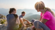 Group of friends chatting on mountain top