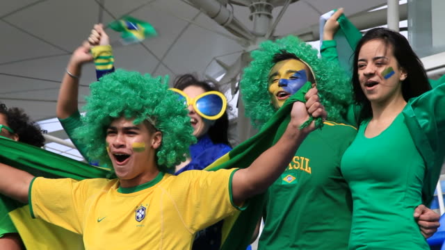Group of friends cheering for Brazil