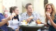 Group of Friends Having an Italian Breakfast and Joking