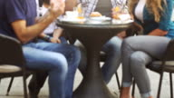 Group of Friends Having an Italian Breakfast at bar