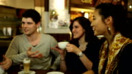 Group of friends having coffee together, Laughing and having fun
