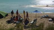 MS, Group of friends having picnic on beach, North Truro, Massachusetts, USA