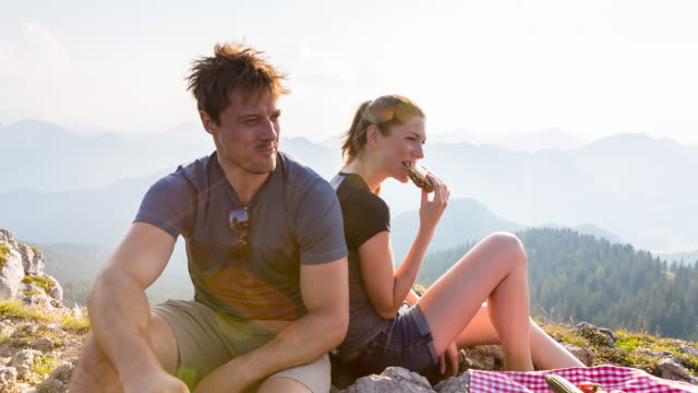 Group of friends having picnic on mountain top