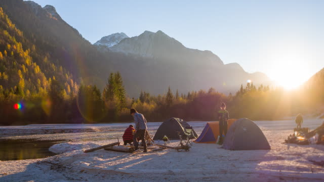 Group of friends setting up camp before the nightfall