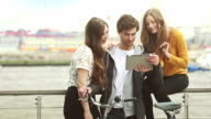 Group of friends taking a selfie with digital tablet