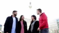 Group of friends talking in Berlin