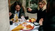 Group of friends together having brunch at restaurant