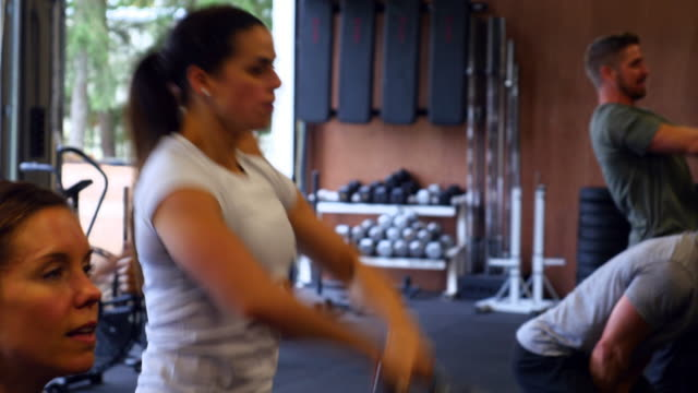 MS Group of friends training with kettle bells in gym gym