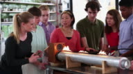 WS DS Group of High School Students and Teacher Performing Science Experiement with Fire and Soundwaves / Richmond, Virginia, United States