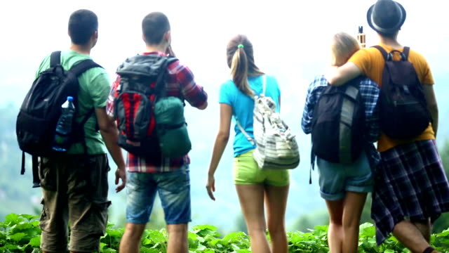 Group of hikers at top of the hill,enjoying panorama.