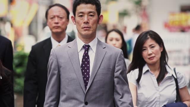 Group of Japanese Professionals Walking Towards Camera