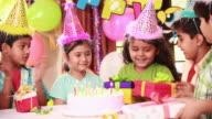 Group of kids celebrating birthday