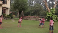 Group of kids playing cricket in holi festival