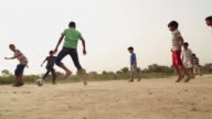 Group of kids playing soccer, Haryana, India