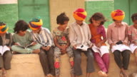 Group of kids reading a book in a school, Jaisalmer, Rajasthan, India