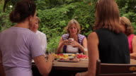 MS PAN Group of ladies having morning tea around table in garden / Perth, Australia