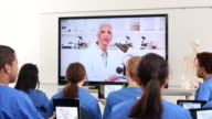 WS DS Group of Medical Students Video Conferencing with Scientist Professor in Laboratory / Richmond, Virginia, United States