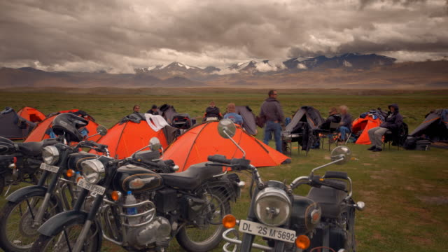A group of motorcyclists camping in the Himalayas