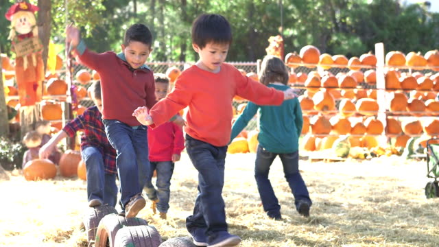Group of multi-ethnic children at fall festival playing