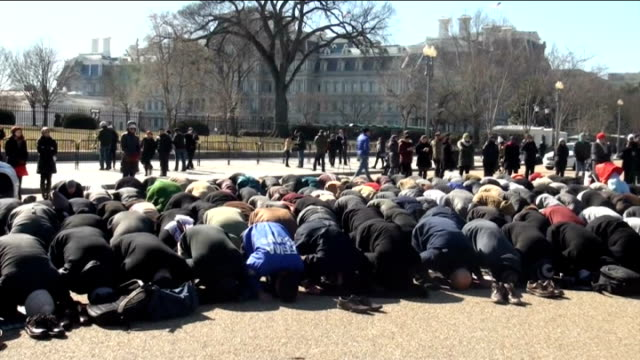 A group of Muslims perform Friday Prayer compulsory prayer for adult men on Islam's holy day Friday in front of the White House to attract the...