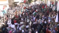 A group of Palestinians gather to protest the continuing blockade of Assad forces and the Syrian opponents on Yarmouk refugee camp located in...