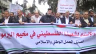 A group of Palestinians gathering at Gaza City's Tomb of the Unknown Soldier hold a protest demanding protection of Palestinian refugees and ending...