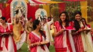 Group of people celebrating durga puja, Kolkata, West Bengal