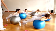 Group of people exercising on fitness balls.