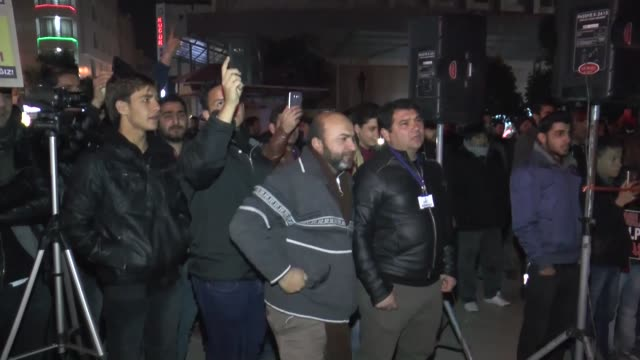 A group of people gathered at January 5 Square in Adana south of Turkey as they protest Assad regime forces' and its supporters' attacks on civilians...