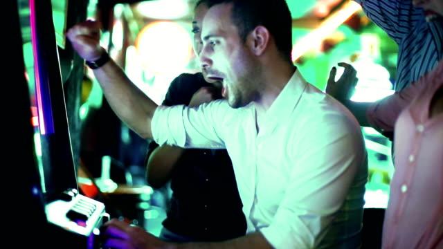 Group of people having fun in casino.